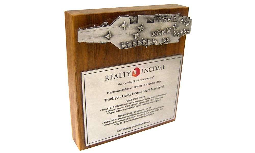 Reality Income Defense Lucite