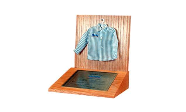 Shirt Hanging on Wood Base | Fashion and Cosmetics